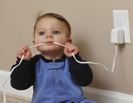 child chewing electric cord