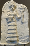 Ishtar holding her symbol. Louvre